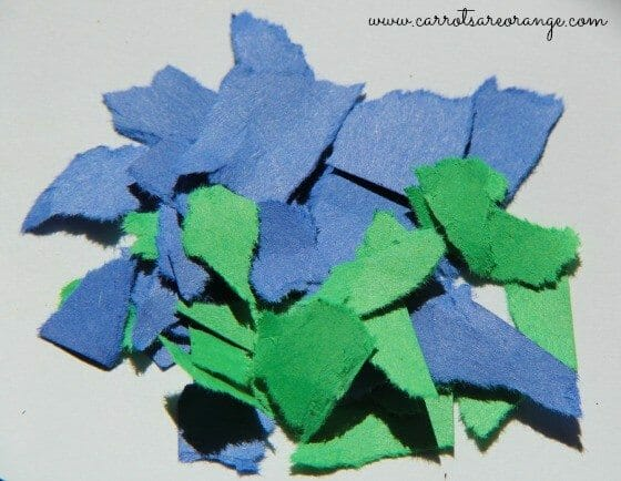 torn paper earth process art