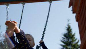 Happy Child Swinging