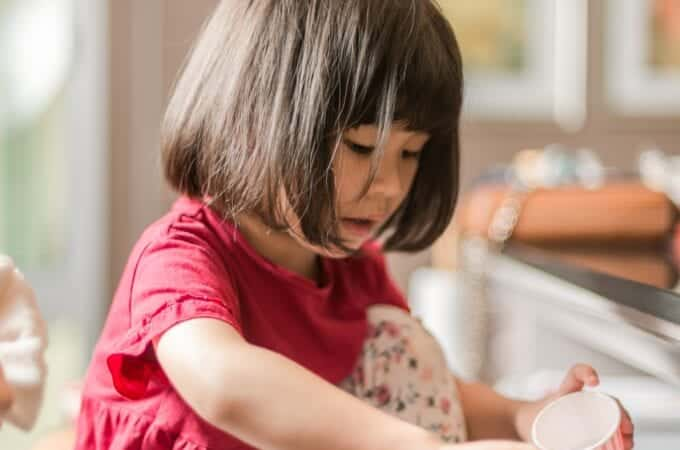 a young girl cooking