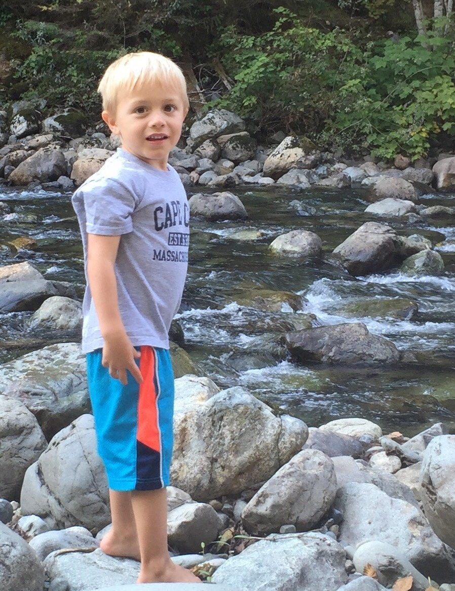 children in nature rocks