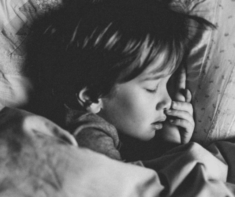 A young boy sleeping