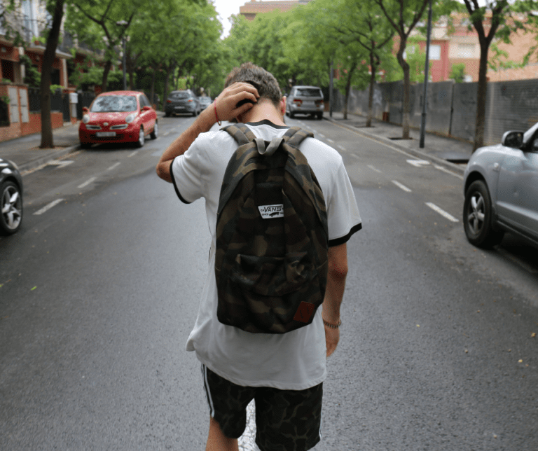 A struggling teenager carries his backpack & needs help organizing.