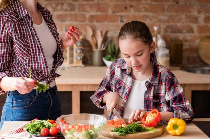 girl cut vegie cook dinner ingredient healthy food