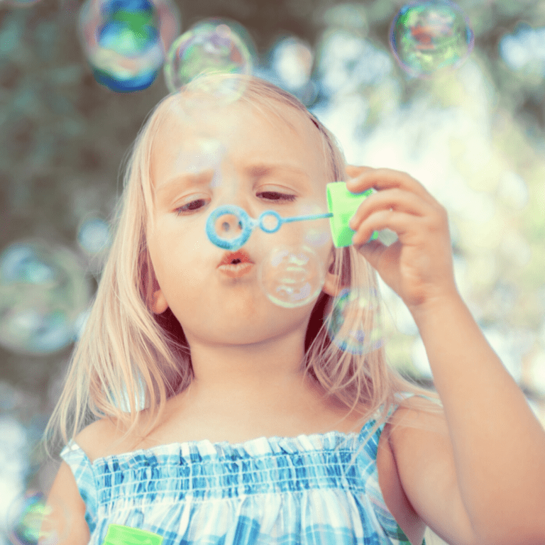 A child blowing bubbles