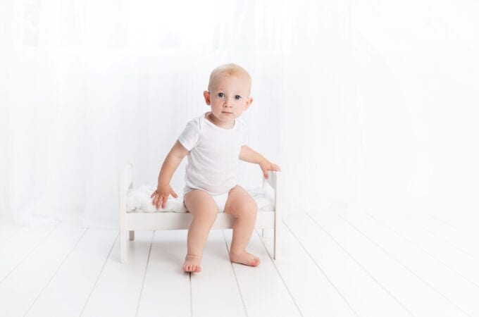 A young boy sitting on the toilet